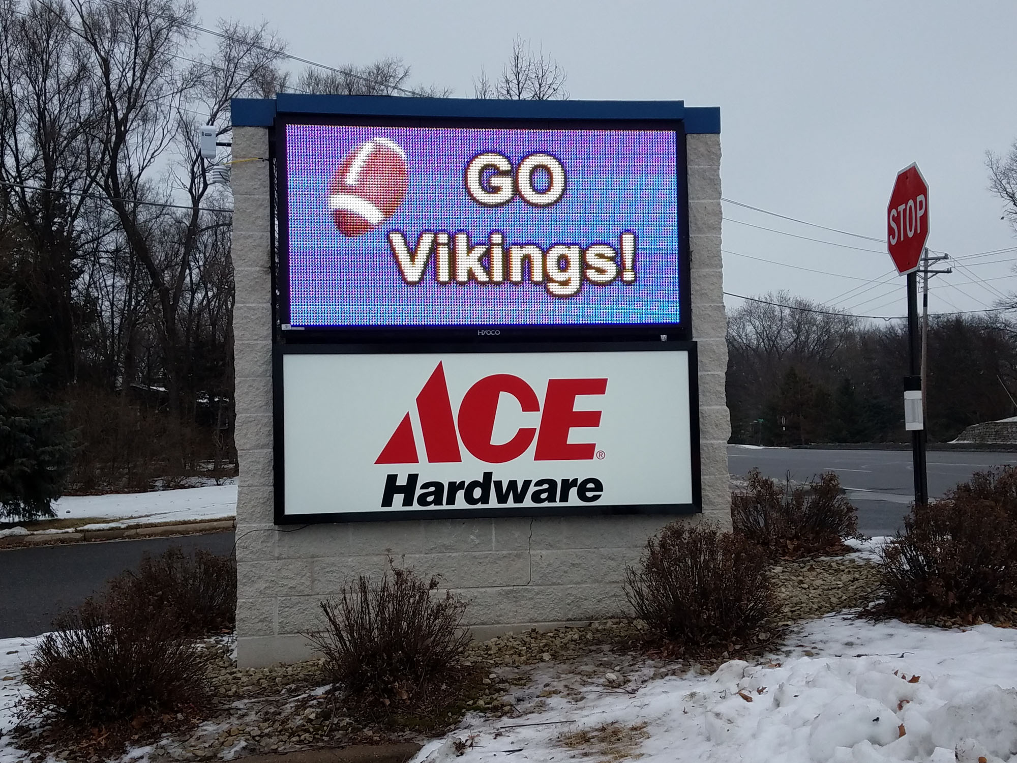 Ace Hardware Coon Rapids, Minnesota Monument sign with digital message center LED illuminated cabinet mounted on brick pillar base