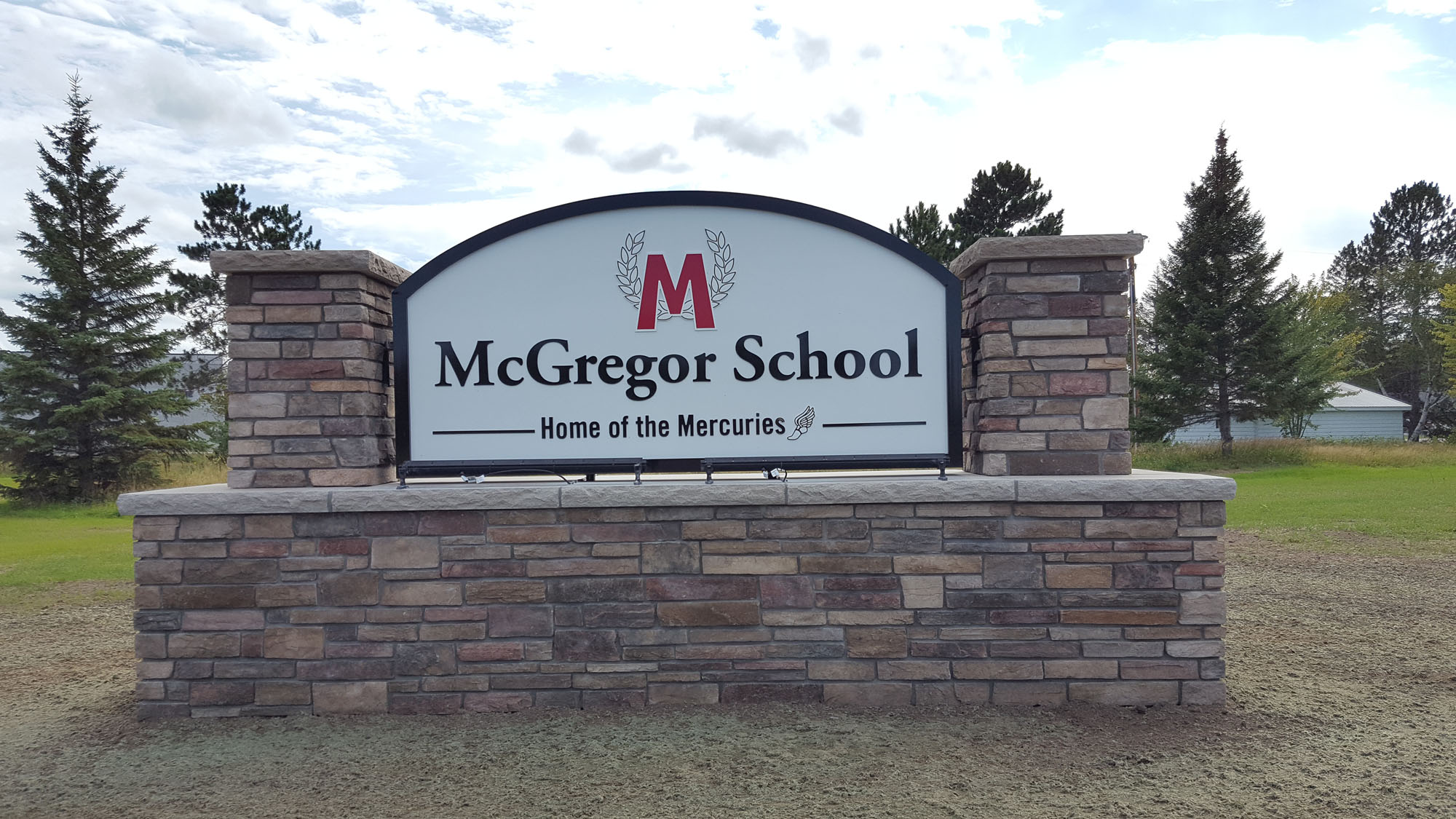 "McGregor School McGregor, Minnesota Non illuminated monument sign with 1_4"" painted aluminum individual letters Stud mounted on cabinet sign - DeMars Signs Minnesota's Original Sign Company"