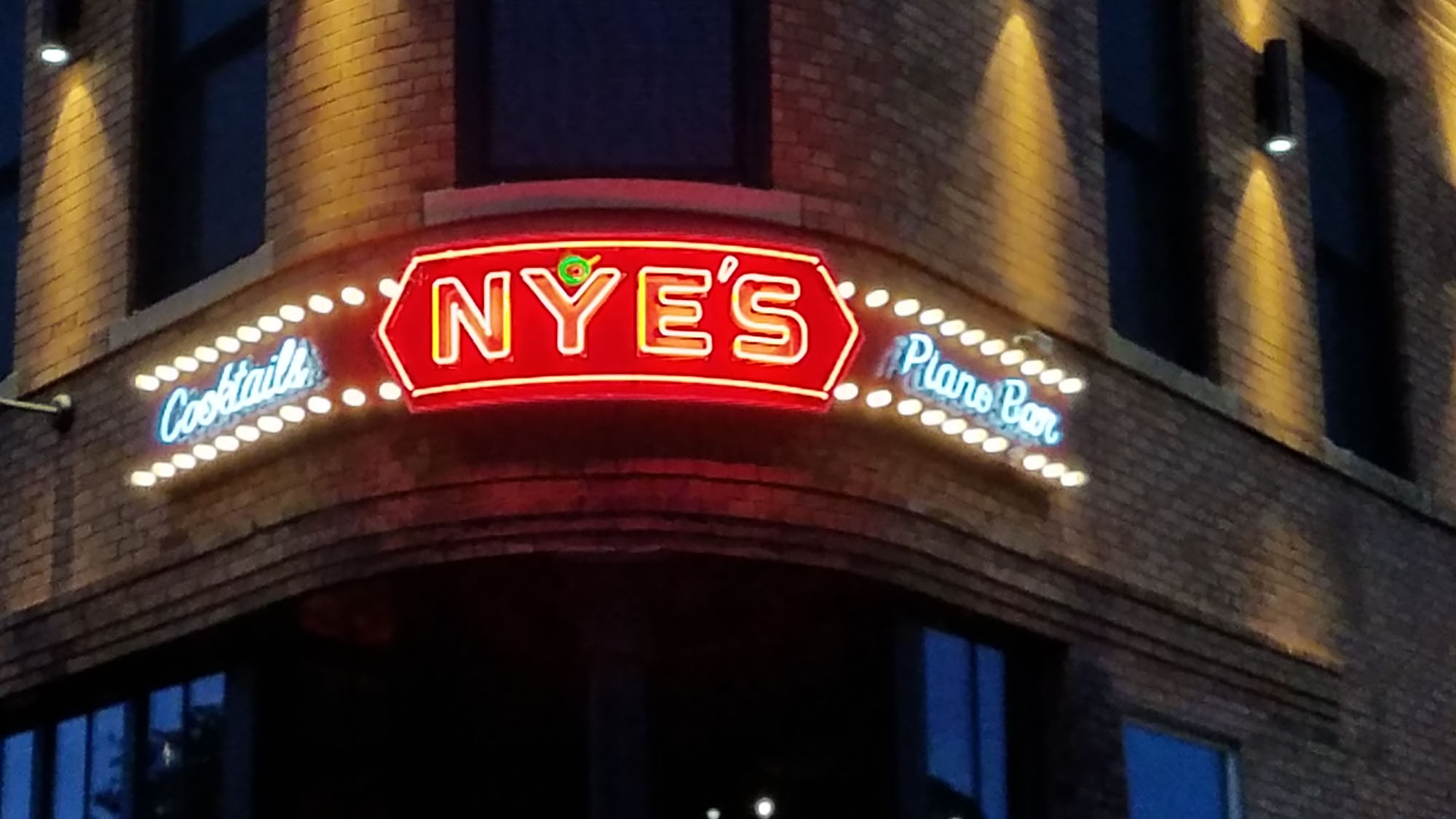 Neon signs for site Nye's Northeast Minneapolis Neon sign mounted to rounded backer