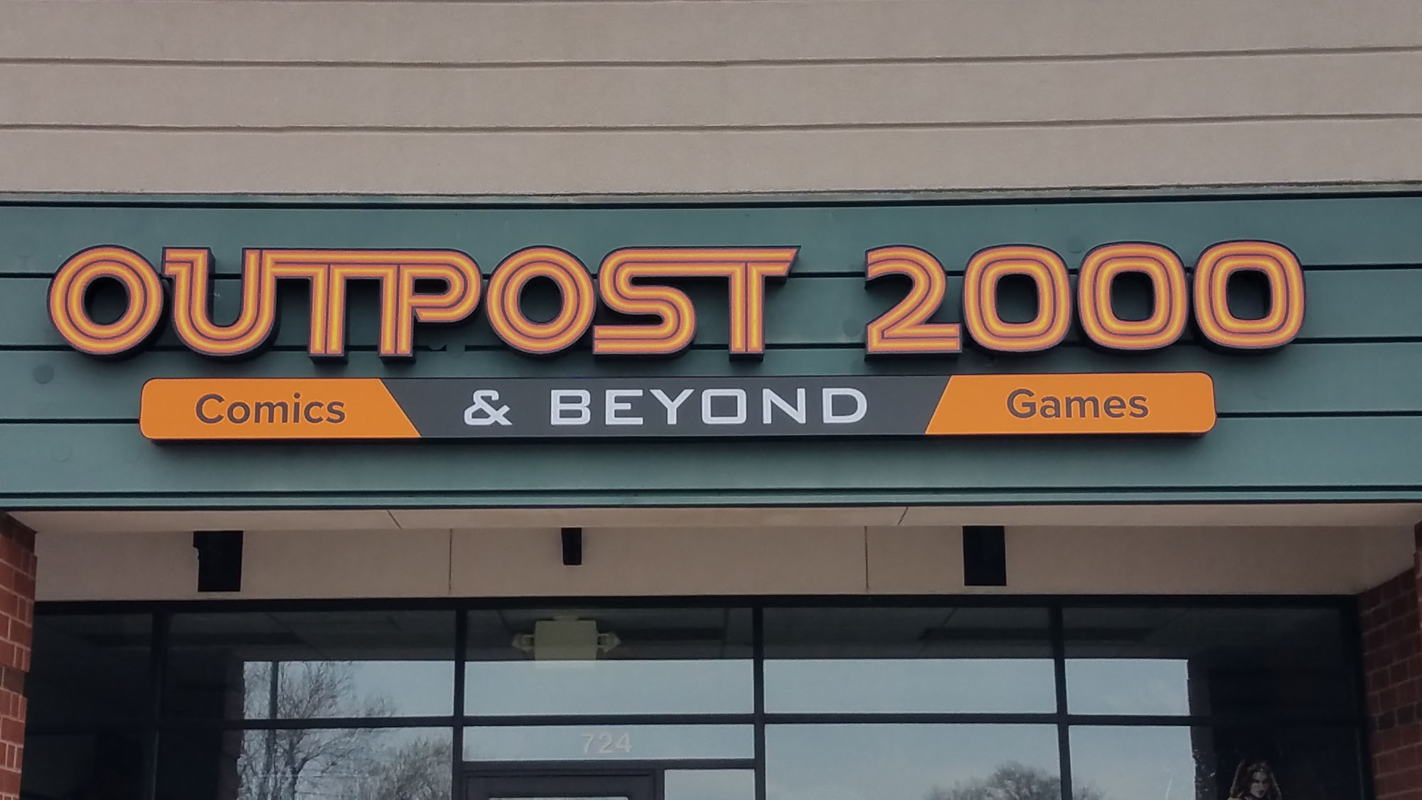 Outpost 2000 Blaine, Minnesota Channel letters with digital printed faces LED illumination Logo cabinet box Direct mount to building - DeMars Signs Company near Minneapolis, MN